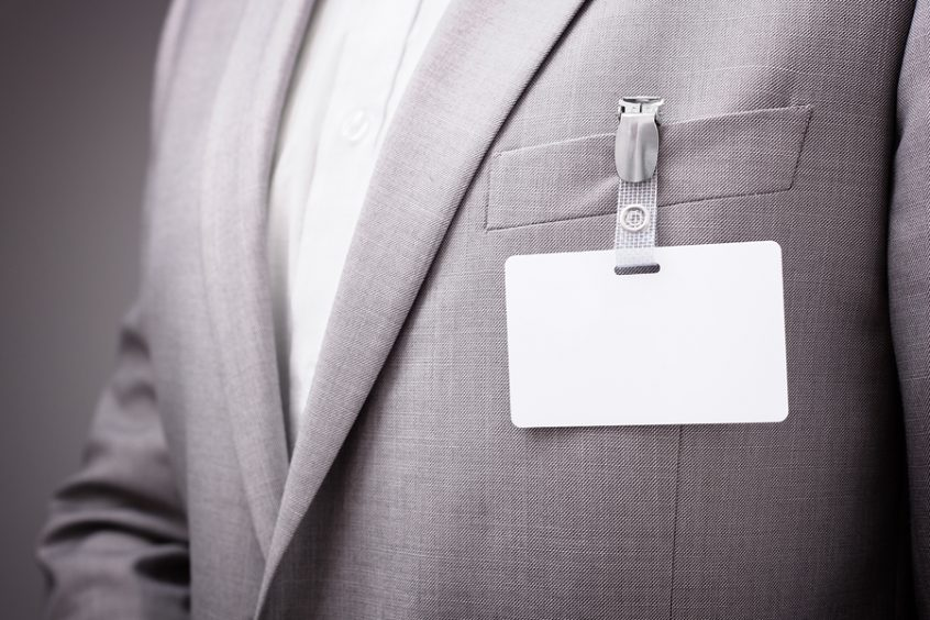 Businessman wearing a visitor badge
