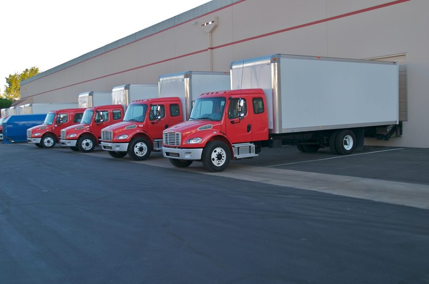 Delivery trucks at loading dock